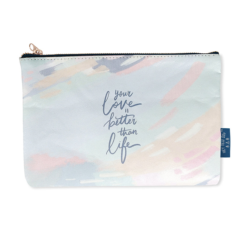 Multipurpose PU Leather pouch in pastel sky design. Features bible verse 'Your love is better than life' in white lettering and is great Christian gift idea. The pouch has inner lining, gold zip. Dimensions: 21cm (W) x 14cm (H)