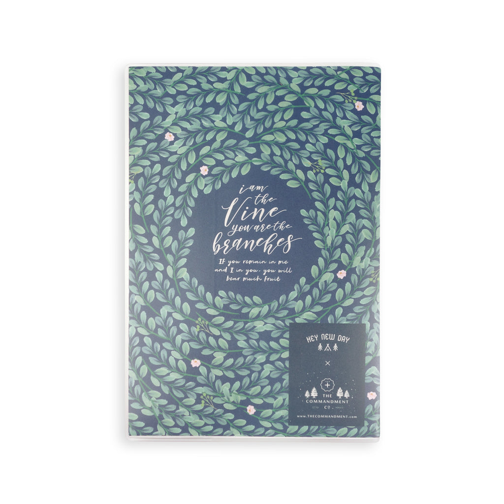 Back view of the garden theme notebook features leaves designs and the full verse. There is a TCCO logo at the bottom right corner.