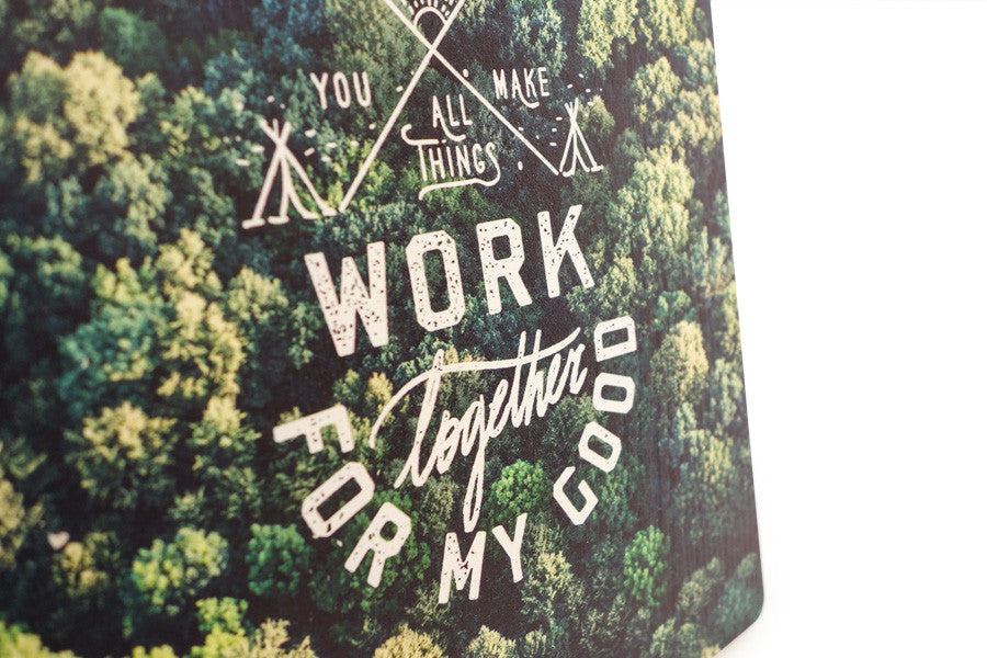 Close up of  Romans 8:28 on a green forest digitally printed on 16cmx20cm quality pine wood.