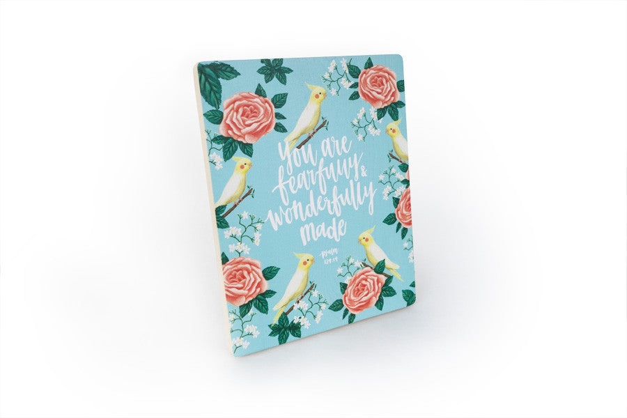 Side view of motivational bible verse 'you are fearfully and wonderfully made' on blue background with birds and roses details digitally printed on 16cmx20cm quality pine wood.