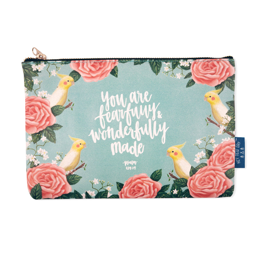 Multipurpose PU Leather pouch in teal with yellow birds designs on it. Features bible verse 'You are fearfully and wonderfully made' in white lettering and is great Christian gift idea. The pouch has inner lining, gold zip. Dimensions: 21cm (W) x 14cm (H)