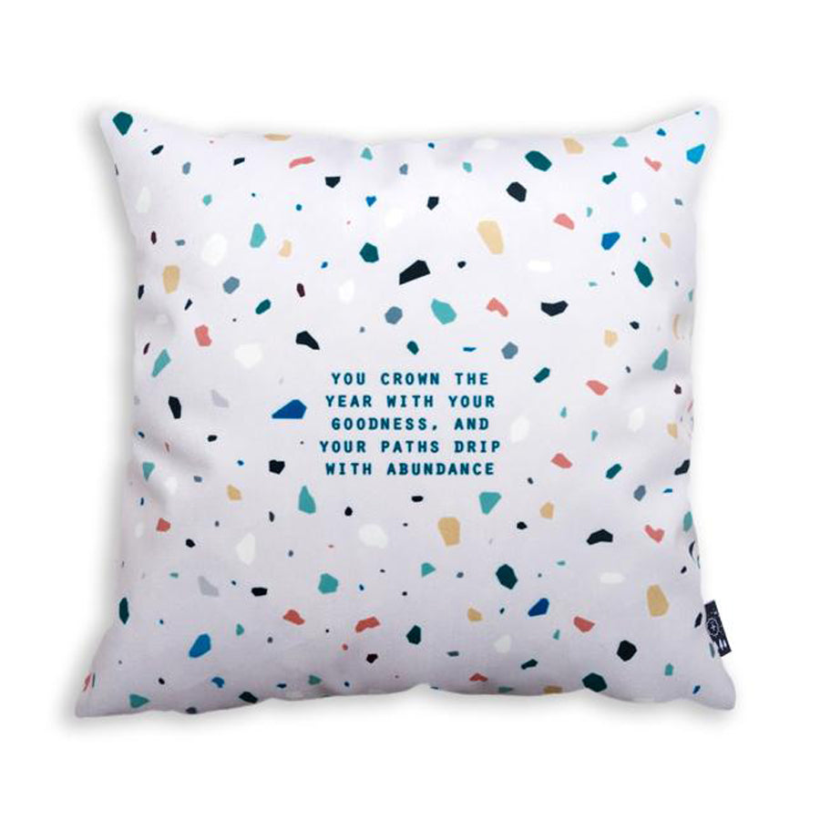 Terrazzo white cushion cover with inspirational bible verse. You crown the year with your goodness and your paths drip with abundance