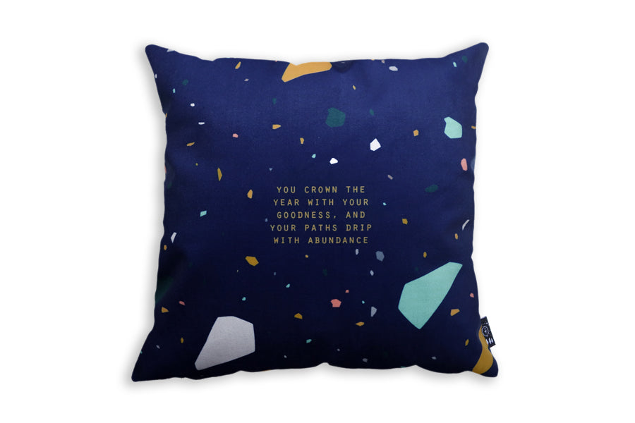 The back of cushion cover same designs but with navy blue background