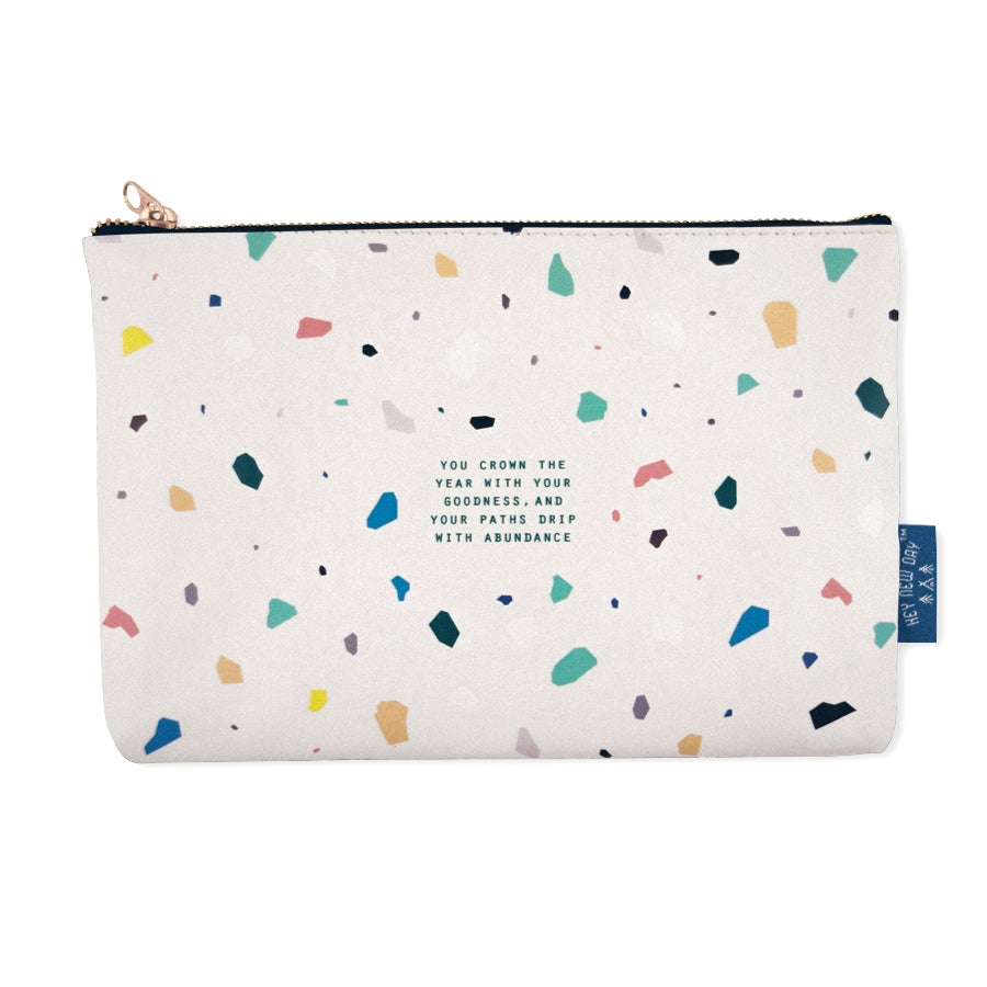 Multipurpose PU Leather pouch in off white with terrazzo designs on it. Features bible verse ' you crown the year with your goodness, and your paths drip with abundance' in blue lettering and is great Christian gift idea. The pouch has inner lining, gold zip. Dimensions: 21cm (W) x 14cm (H)