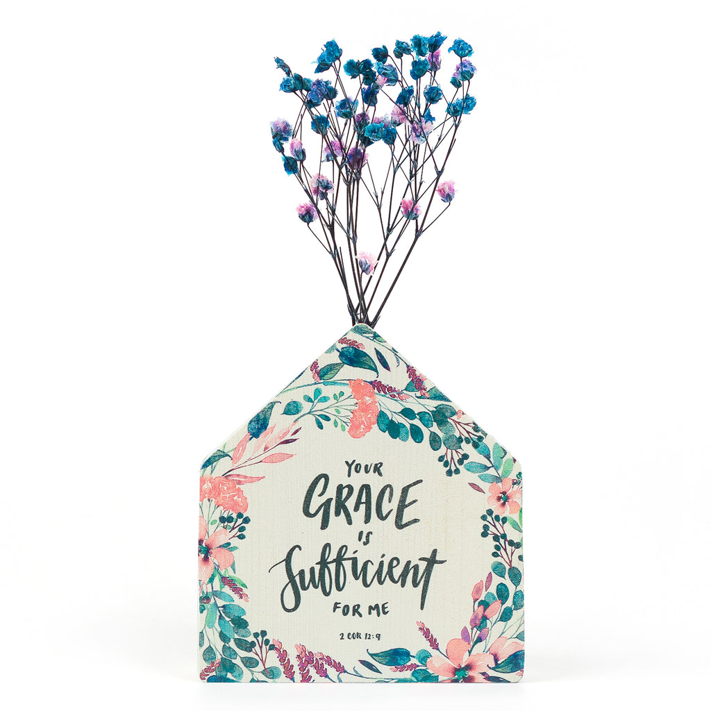 Wooden house in the shape of a brush swatch vase. With flowers details and blue letter typography of 'Your grace is sufficient for me'. Decorated with dried blue and pink baby's breath.