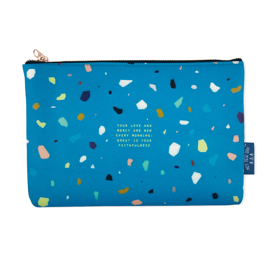 Multipurpose PU Leather pouch in blue with terrazzo designs on it. Features bible verse ' your love and mercy are new every morning; great is your faithfulness' in white lettering and is great Christian graduation gift idea. The pouch has inner lining, gold zip. Dimensions: 21cm (W) x 14cm (H)