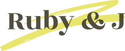 Ruby & J Logo in black writing on a yellow swirl