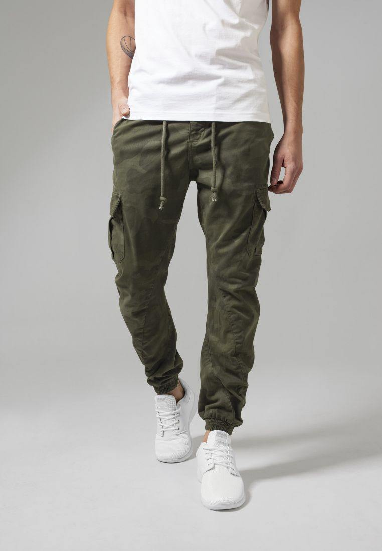 Camo Cargo Jogging Pants The Camo Cargo Jogging Pants from URBAN CLASSICS redefine the typical look of sweat pants. The camo pattern and the cargo-style pockets are a breach of style compared to the sporty attitude of original sweat pants. The result is simply unique. The drawstrings and the elastic leg openings make sure the pants always fits you right, while the cotton fabric with stretch feels super comfortable. Available at My Harley and Rose.