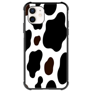 Black cows with big spots
