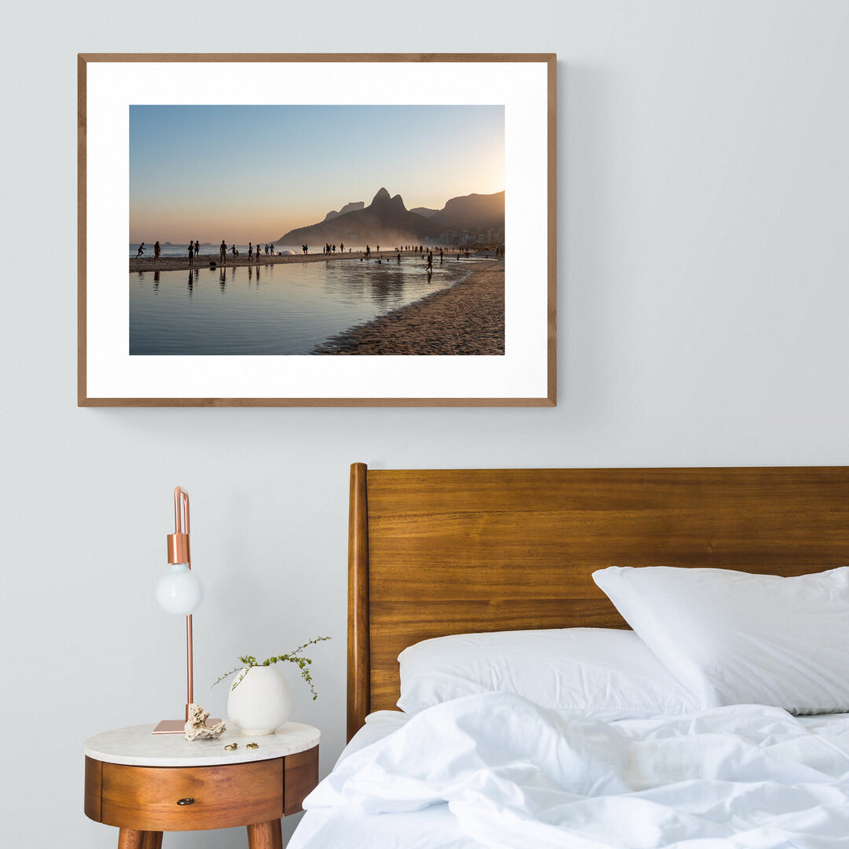 Mounted and framed Photograph  of silhouettes at sunset on Ipanema Beach in a bedroom setting