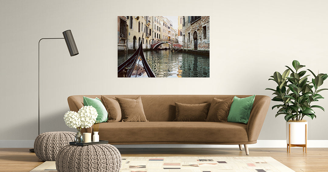 Photo on Aluminium of the front prow of a gondola points along the Venice canals as it travels towards the next bridge.