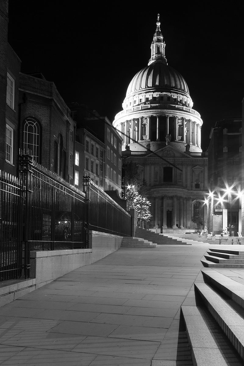A monochrome of an eerie night scene of an empty London street leading up to St Pauls Cathedral on a late September evening.