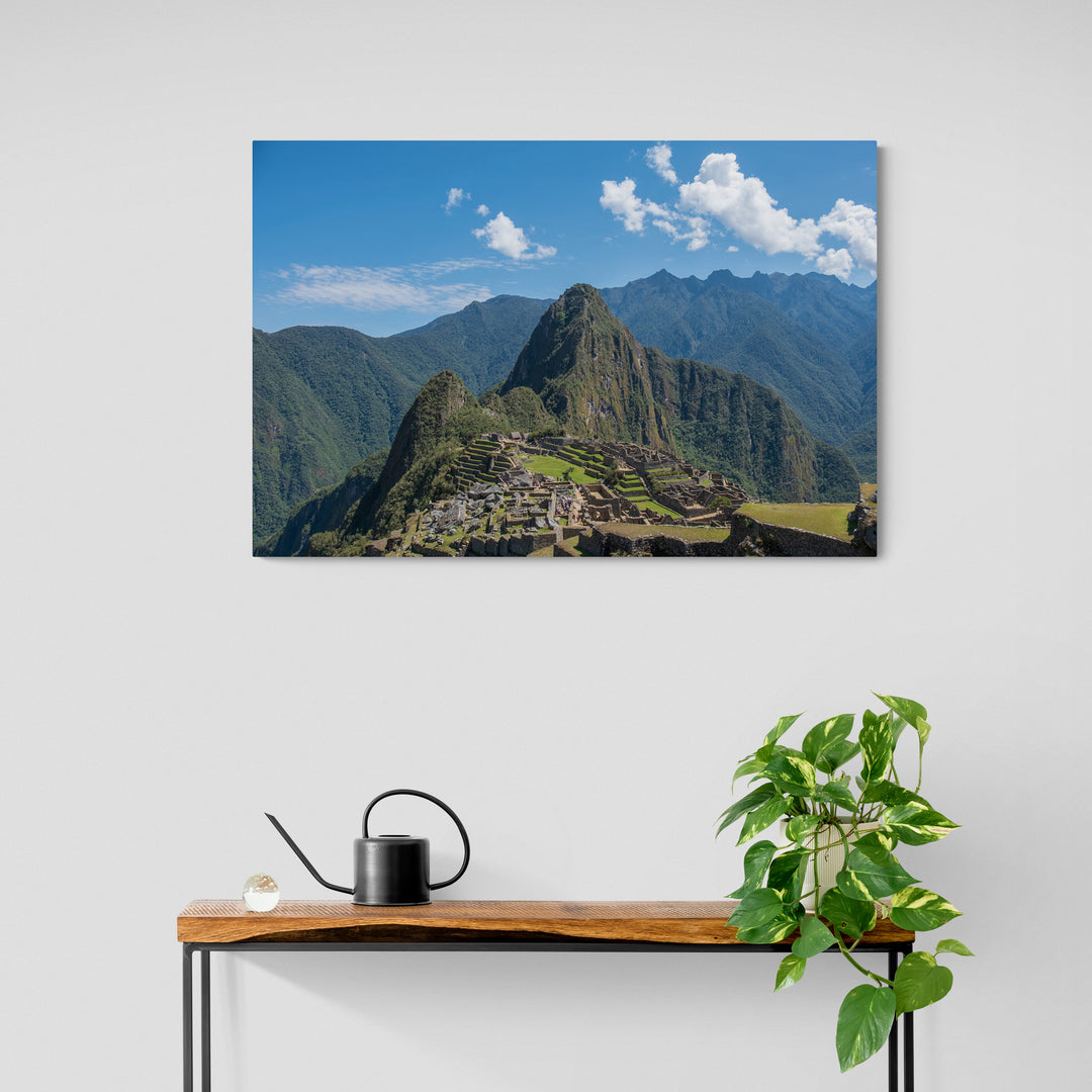 Aluminium photograph of the Incan city of Machu Picchu surrounded by mountains as viewed from the Sun Gate above the city.