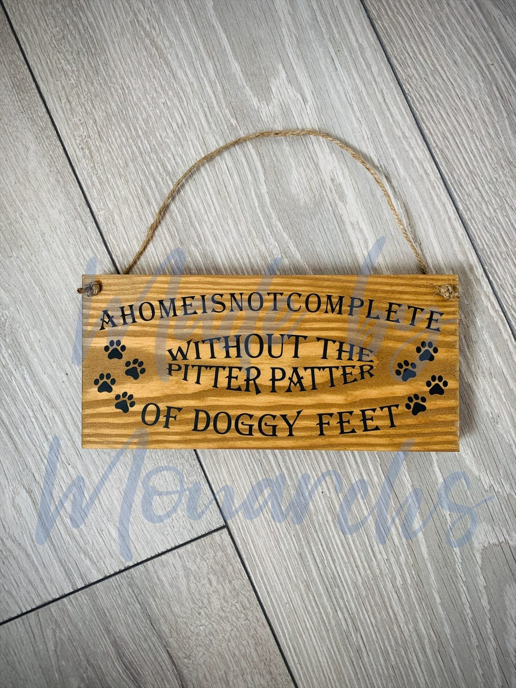 'A Home Is Not Complete Without The Pitter Patter' Wooden Sign
