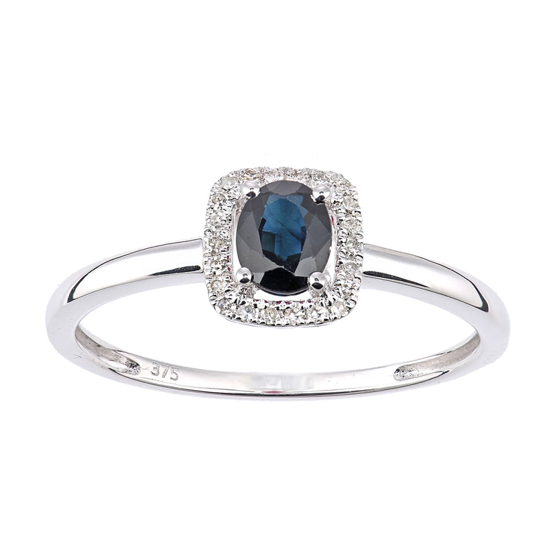 0.5ct Oval Sapphire And Round Diamond Halo Ring In UK Hallmarked 9ct White Gold