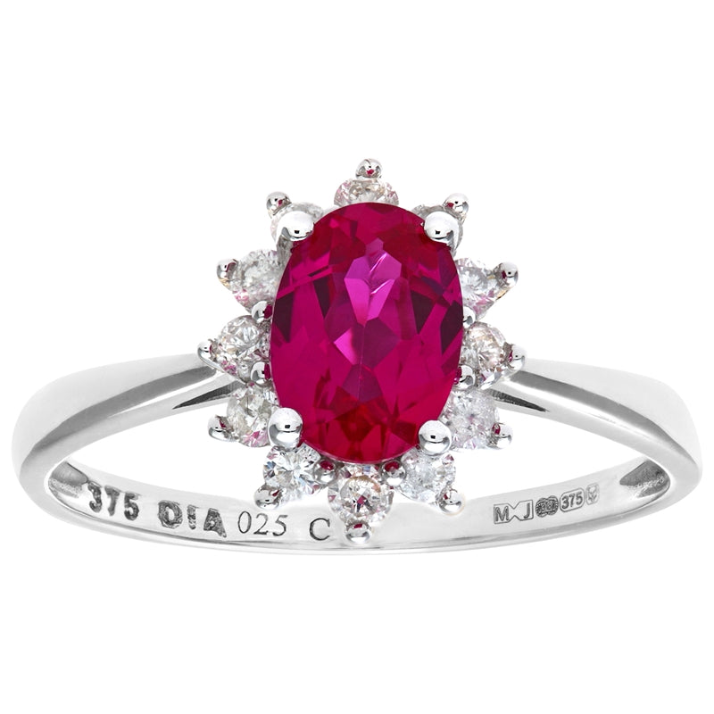 1.1ct Oval Ruby And 0.25ct Round Diamond Cluster Ring In UK Hallmarked 9ct White Gold