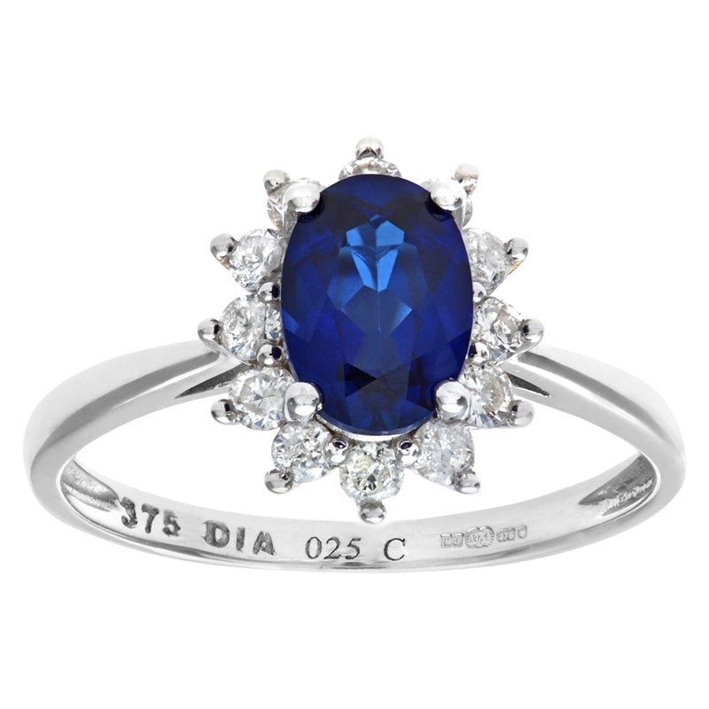 1.09ct Oval Sapphire And 0.25ct Round Diamond Cluster Ring In UK Hallmarked 9ct White Gold