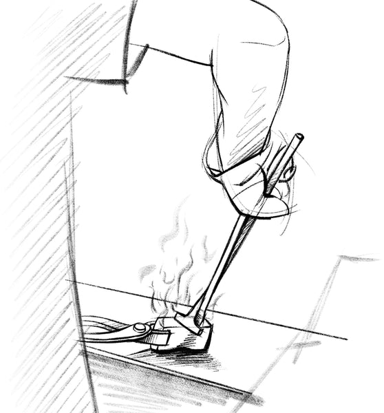 A sketch of hot steel being worked on a flat surface with tongs and a metal working tool.