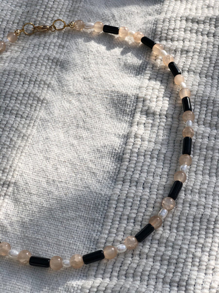 Neutral Glass with Pearl Necklace