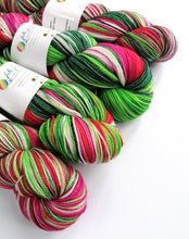 Load image into Gallery viewer, The Yarn That Stole Xmas, hand dyed on a high twist Superwash Merino/Nylon sock yarn.