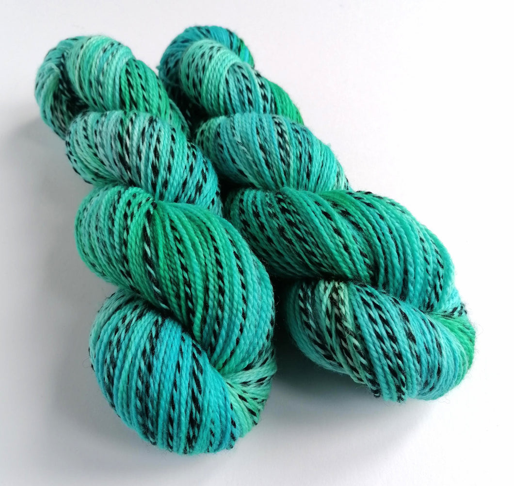 Blues and greens, hand dyed on a Superwash Merino 'Zebra' 4ply yarn.