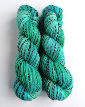 Load image into Gallery viewer, Blues and greens, hand dyed on a Superwash Merino 'Zebra' 4ply yarn.