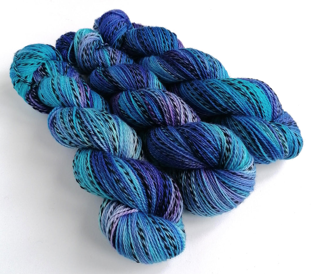 Blues and purples, hand dyed on a Superwash Merino 'Zebra' 4ply yarn.