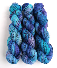Load image into Gallery viewer, Blues and purples, hand dyed on a Superwash Merino 'Zebra' 4ply yarn.