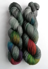Load image into Gallery viewer, Dark Winter Rainbow on a Superwash Merino/bamboo 4ply/fingering weight.