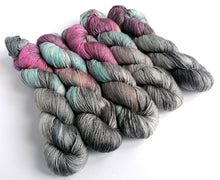 Load image into Gallery viewer, Dream Dangerously on superwash merino/silk singles 4ply/fingering weight.
