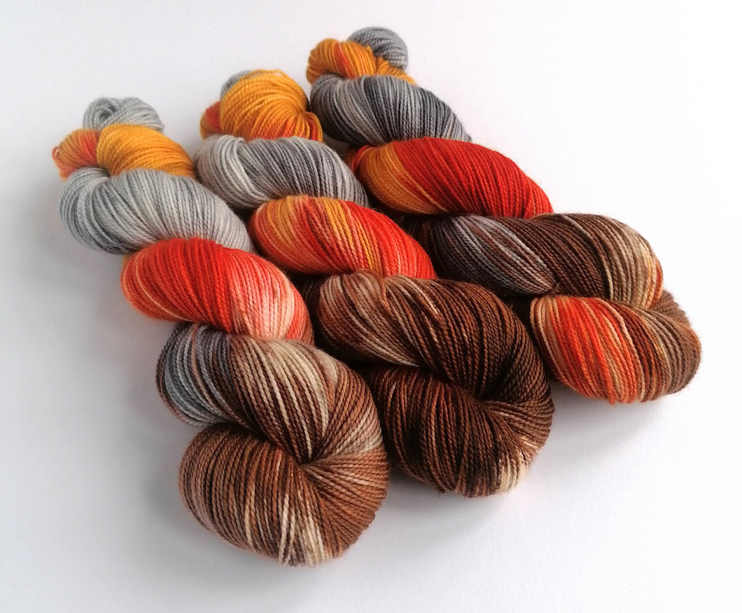 Embers Revised on a high twist Superwash Merino/Nylon sock yarn.