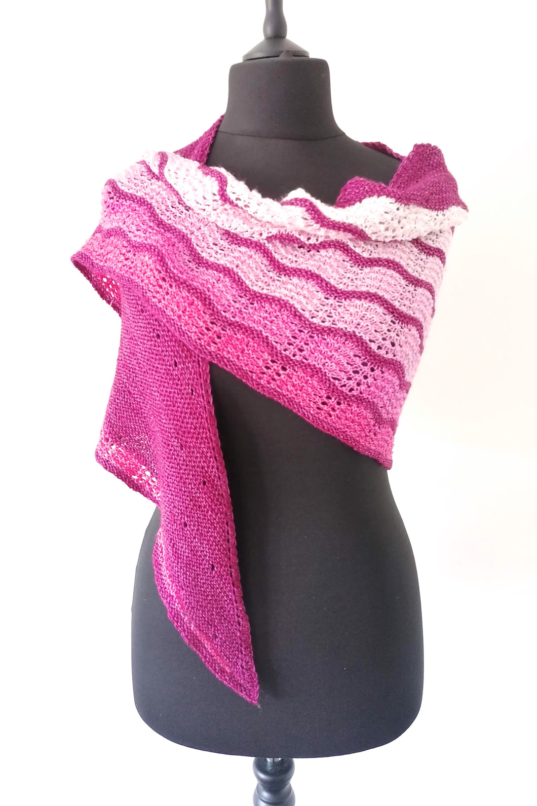 Hand knitted pink gradient shawl.