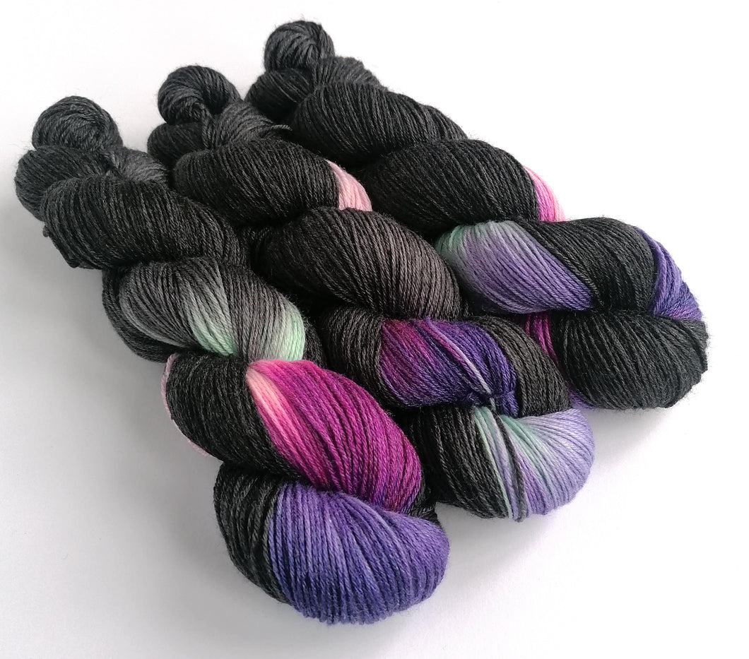 Gothic Bouquet on a Superwash Merino/bamboo 4ply/fingering weight.