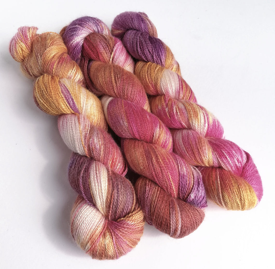 Ice and solar dyed baby alpaca/silk lace weight yarn.