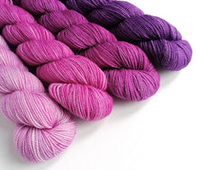 Load image into Gallery viewer, Pink and purple yarn set on a superwash merino/nylon/sparkle sock yarn.