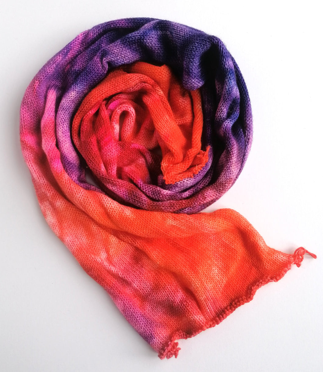 Hand dyed sock blank in a Superwash Merino/Nylon base in orange, pink and purple.