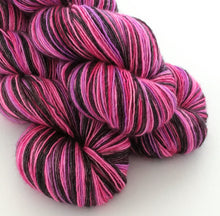 Load image into Gallery viewer, Pop Your Cherry on superwash Merino/Silk singles 4ply/fingering weight.