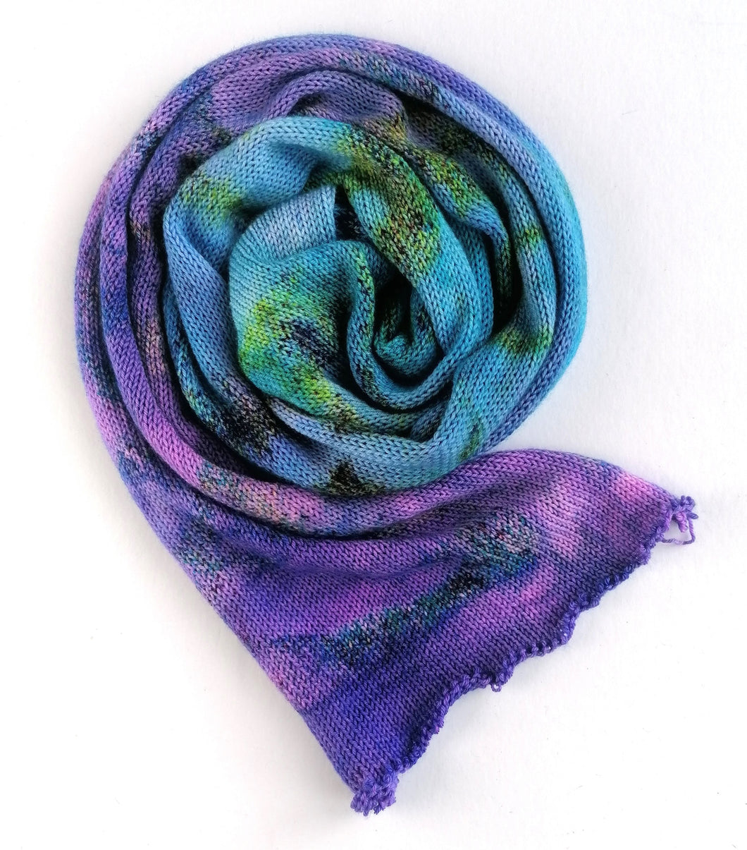 Hand dyed sock blank in a Superwash Merino/Nylon base in purple and blue.
