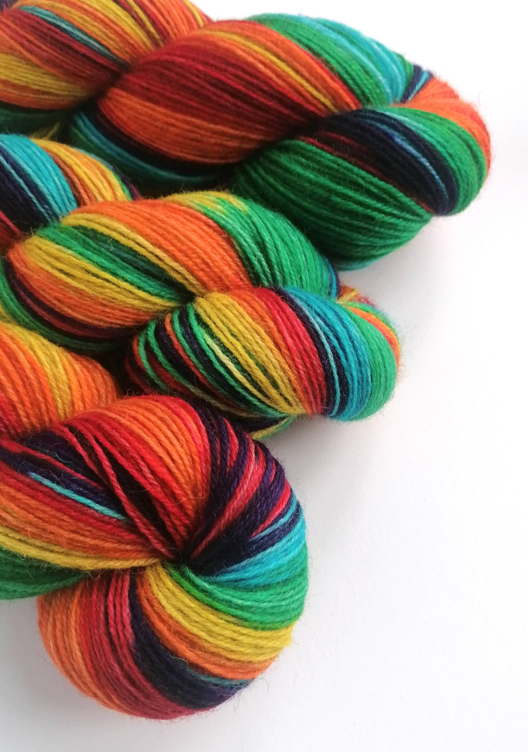 Rainbow, hand dyed on a British wool sock yarn.