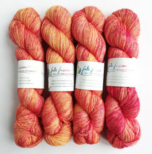Load image into Gallery viewer, Rosy Maple Haze on superwash Merino singles base 4ply/fingering weight.