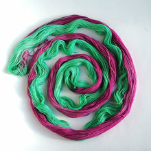 Load image into Gallery viewer, Hand dyed Self-Striping sock yarn on a Superwash Merino/Nylon base in pink and speckles.