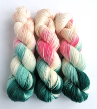 Load image into Gallery viewer, Sicilian Defense on superwash merino/cashmere/nylon sock yarn.