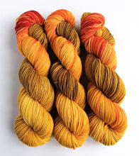 Load image into Gallery viewer, Smaug, hand dyed on Superwash Merino crazy 8 DK.