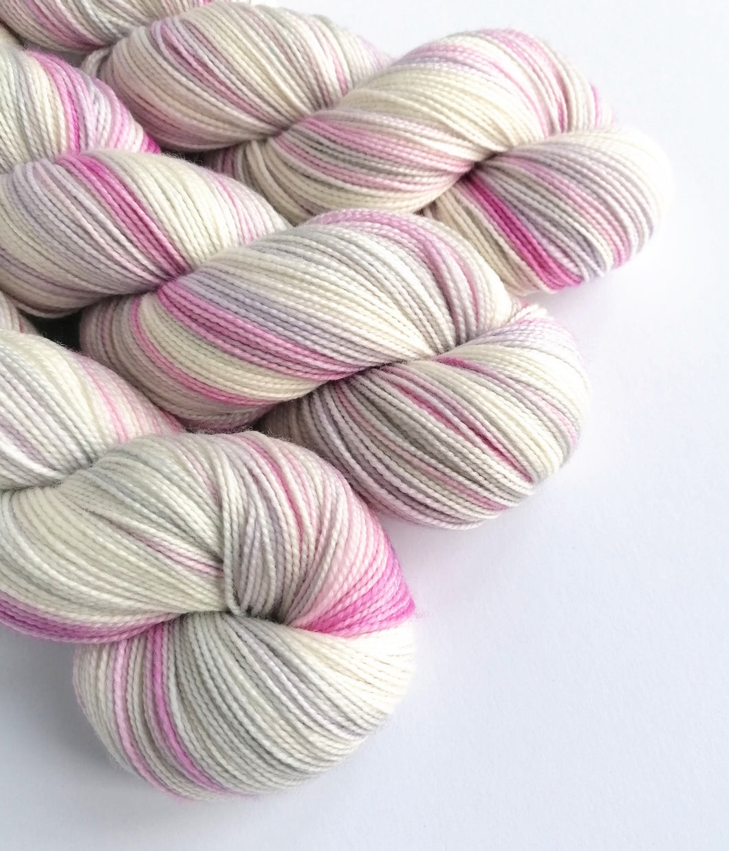 Snow Fairy on a high twist Superwash Merino/Nylon sock yarn.