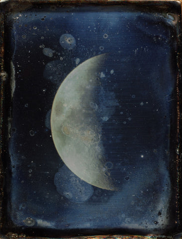 Image of a whipple moon on an artistically stained antique card.