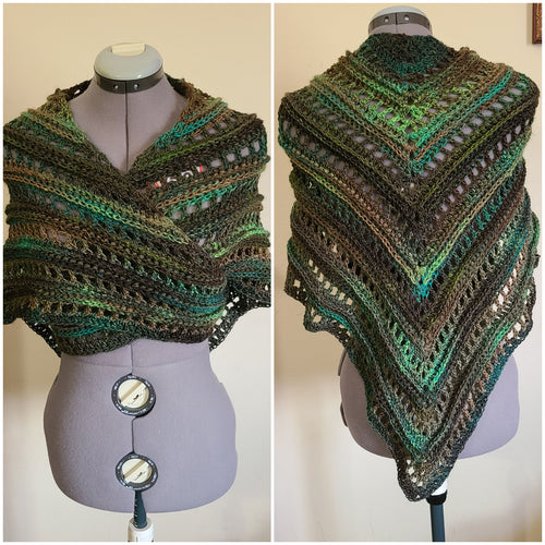 A trianglular shawl with bright green, olive and forest green stripes.