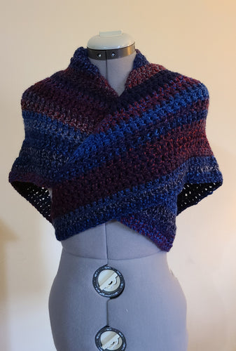 Front view of triangular shawl with maroon and navy blue stripes.