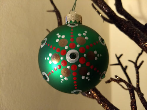 Gold and red design on a green ornament. Embellished with crystal.