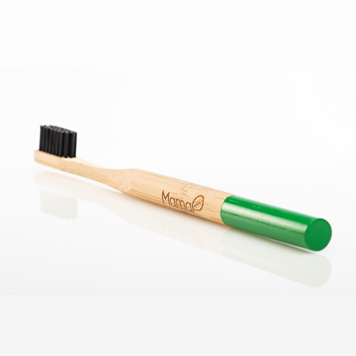 Bamboo toothbrush with black bristles and a green handle.