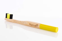 Load image into Gallery viewer, Bamboo toothbrush with black and yellow bristles and a yellow handle.
